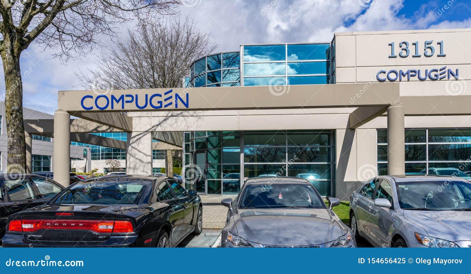 RICHMOND, CANADÁ - 26 DE MARZO DE 2019: edificio moderno del negocio con el estacionamiento y los coches de oficinas