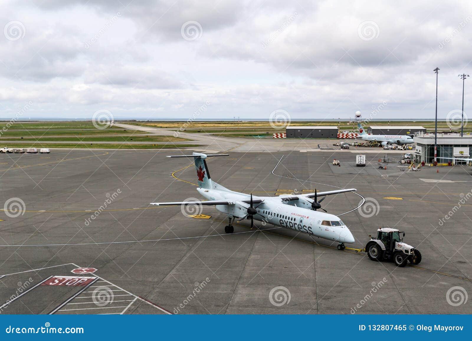 RICHMOND, CANADA - 14 septembre 2018 : La vie occupée aux avions et à la cargaison d aéroport international de Vancouver
