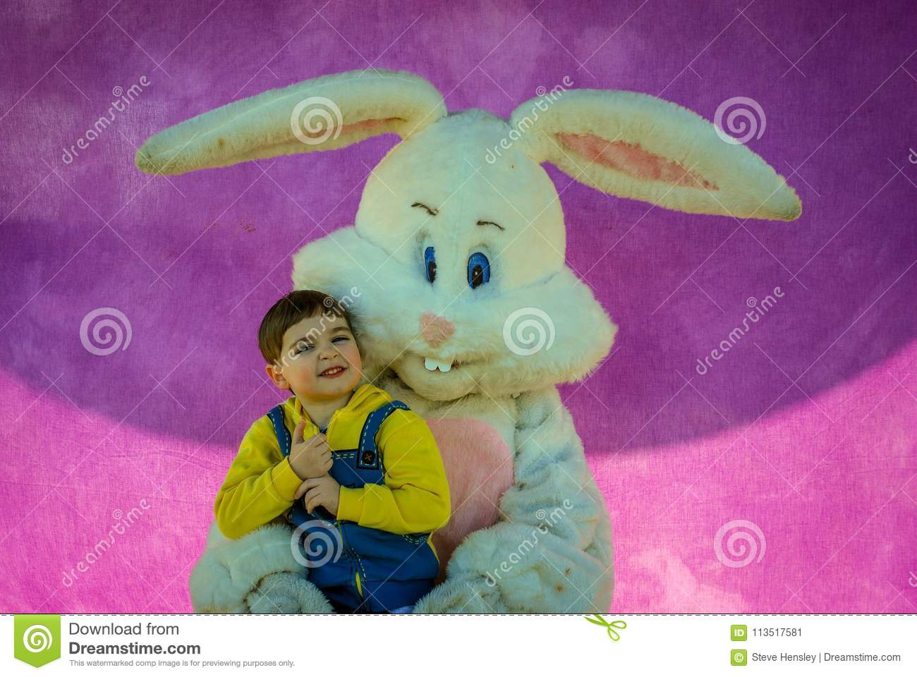 Richmond, KY US - March, 31 2018 - Easter Eggstravaganza - A boy poses with an Easter Bunny character for a photo,