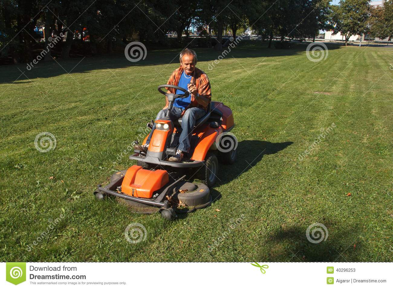 Ride on lawn mower cutting grass stock photo image for Lawn mower cutting grass