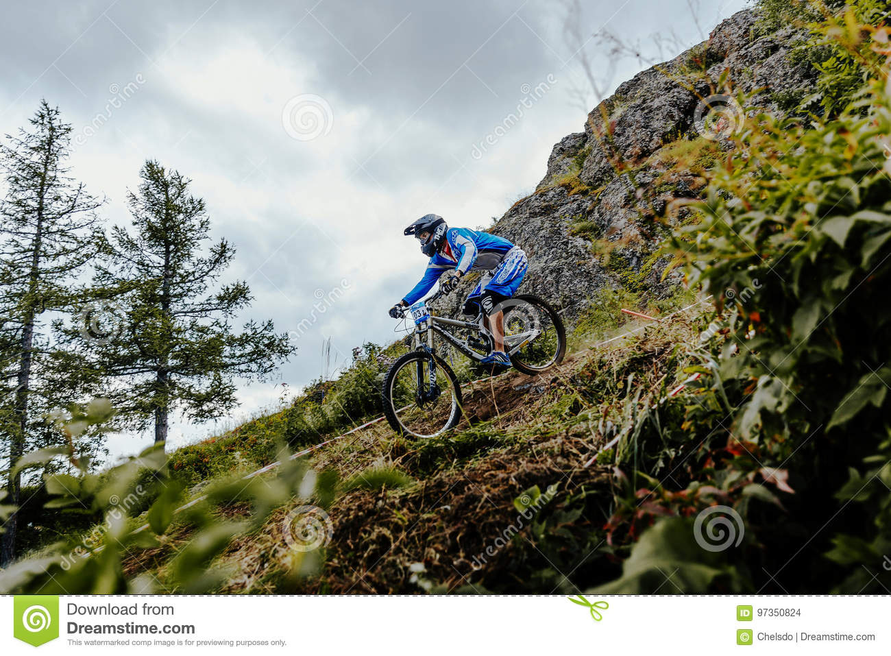 Rider on bike downhill mountain and forest track