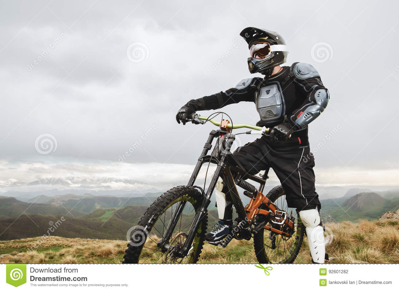 The Rider In The Full Face Helmet And Full Protective Equipment On