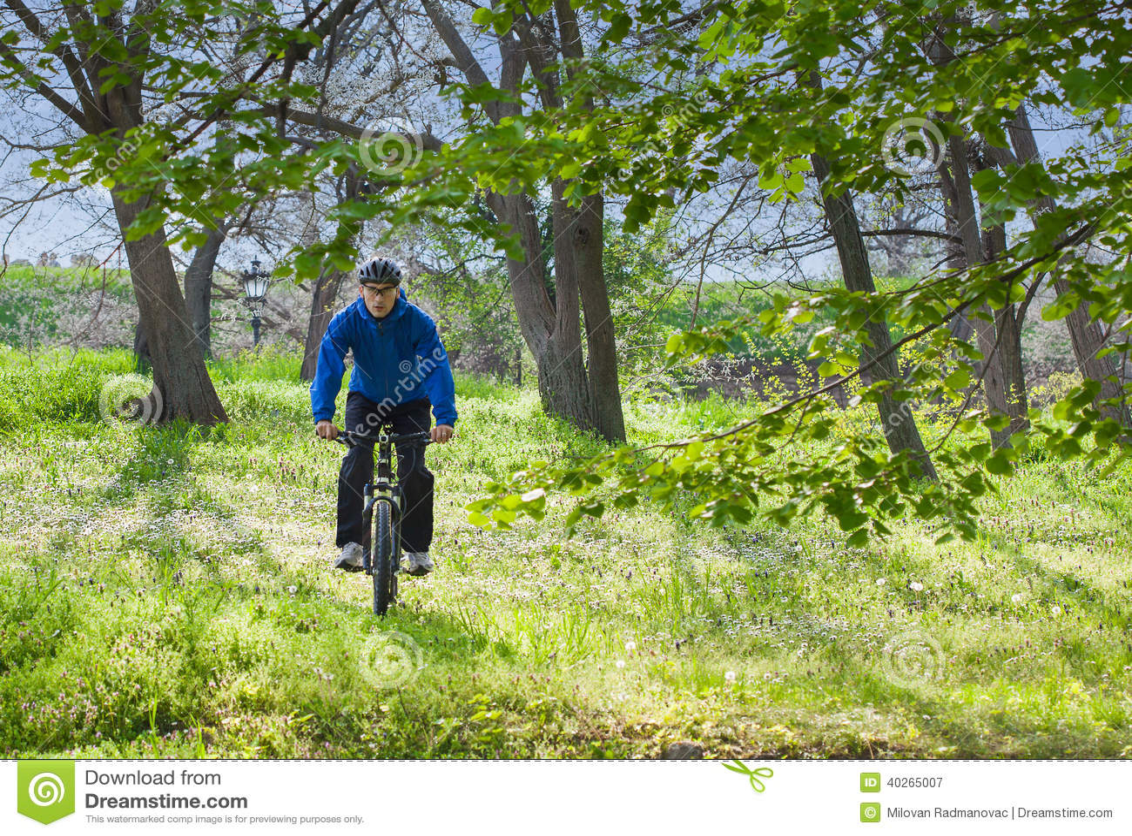 Riding Bicycle Stock Photo