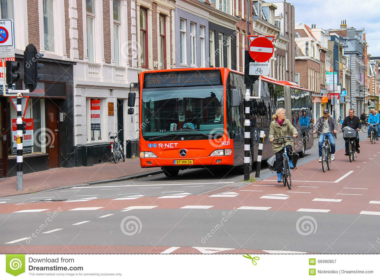 Riding a bike people and big bus in Haarlem