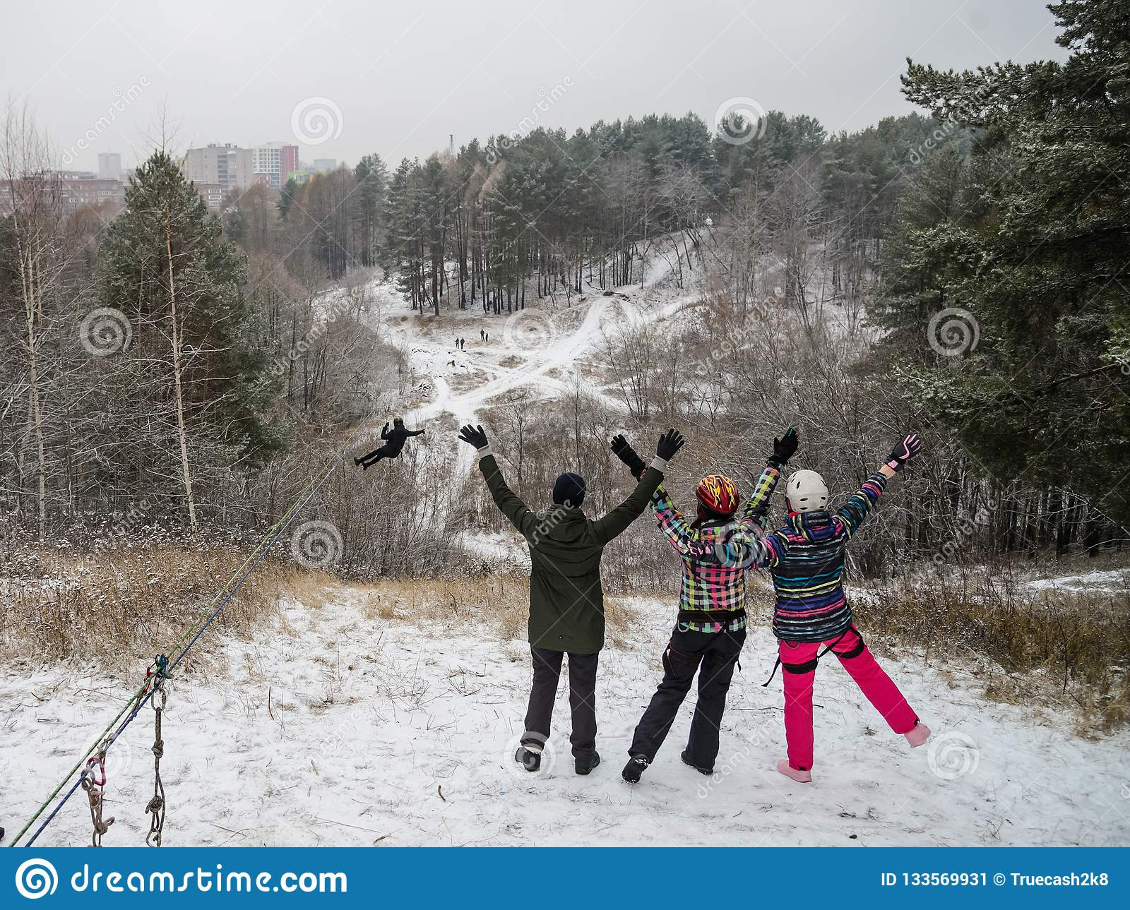 Riding on rope trolley Track in winter. People having fun together. Extreme and active lifestyle.