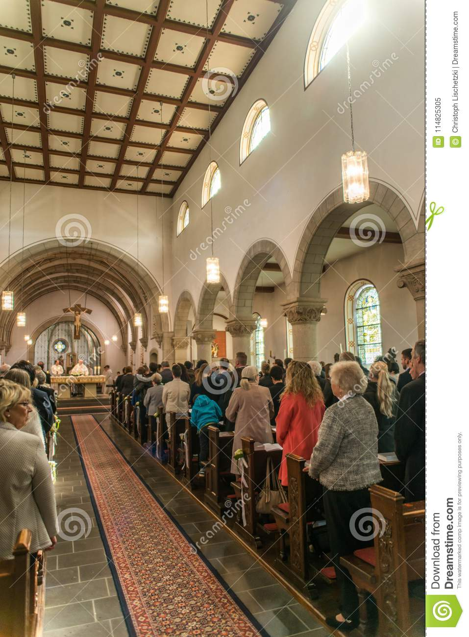 Rieden Germany 15.04.2018 Priest holding church service in front of crowd in theinterior of a church
