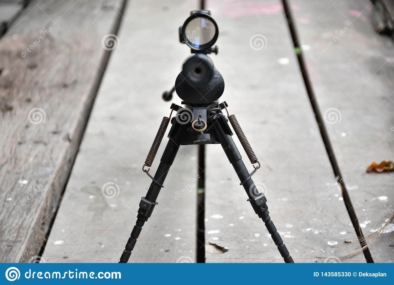 Rifle with a scope and bipod