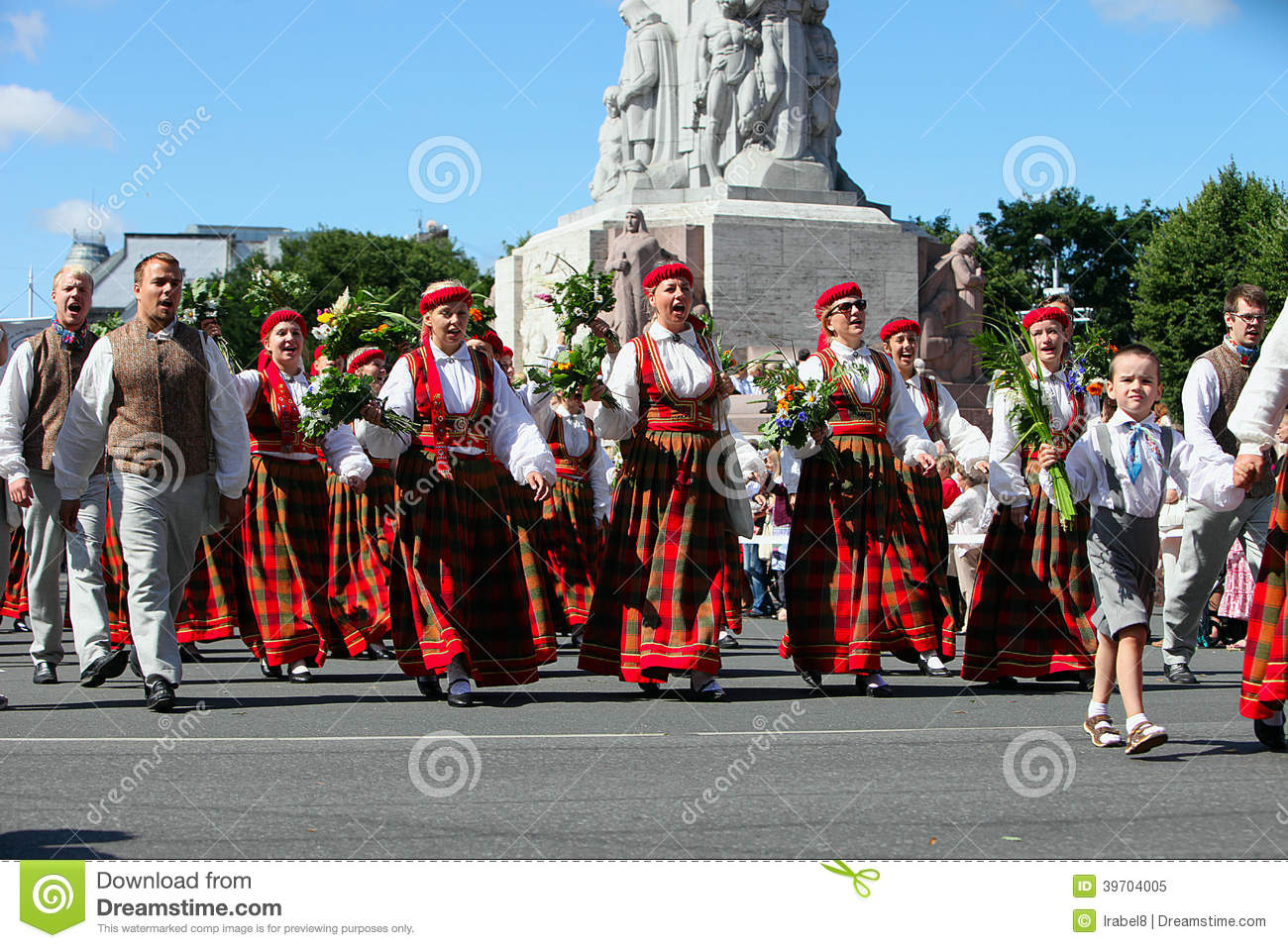 RIGA, LATVIA - JULY 06: People in national costumes at the Latvian National Song and Dance Festival on July 06, 2013. Holiday was