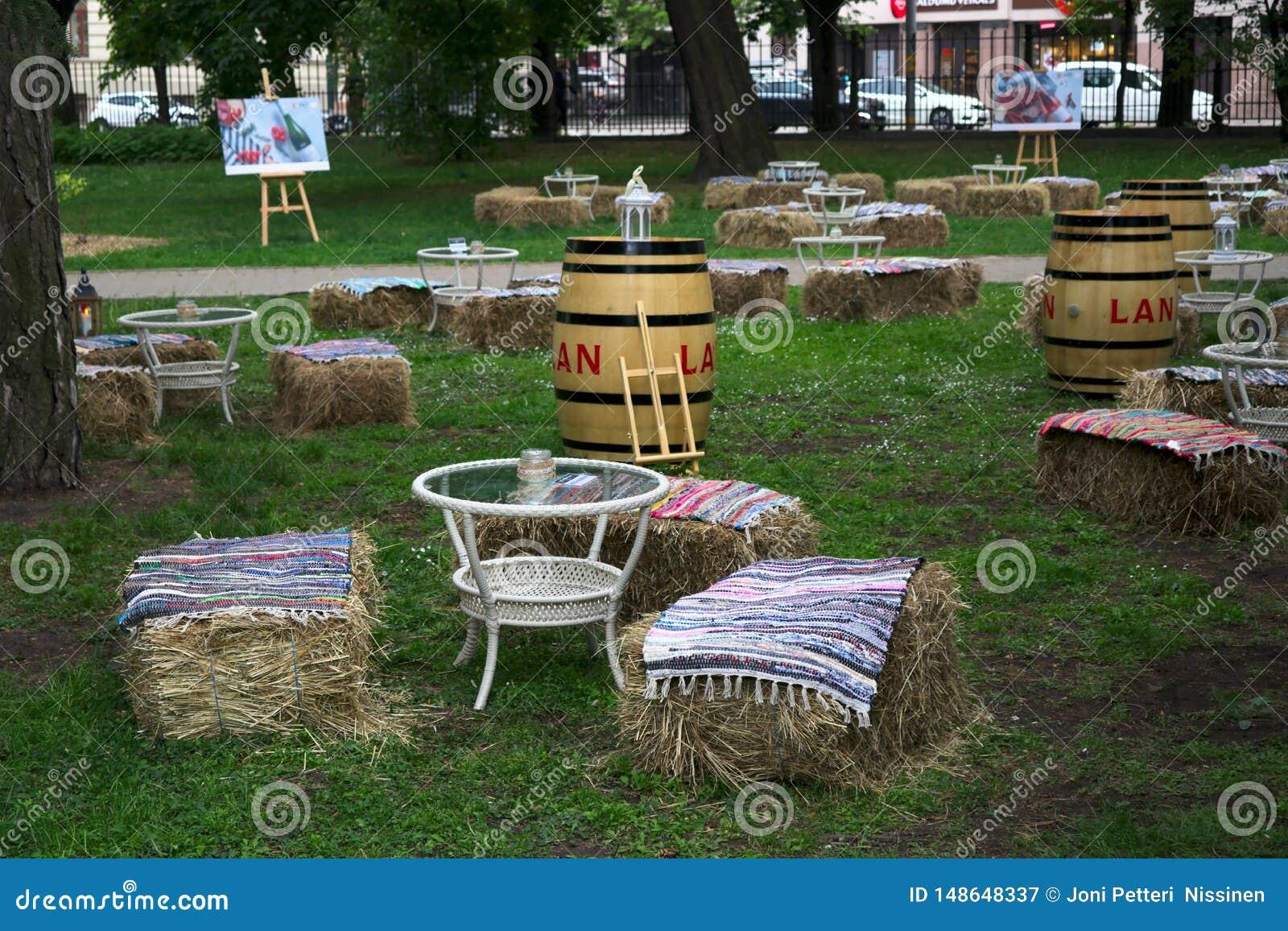 Riga, Latvia - May 24 2019: Cozy looking terrace to enjoy drinks in park