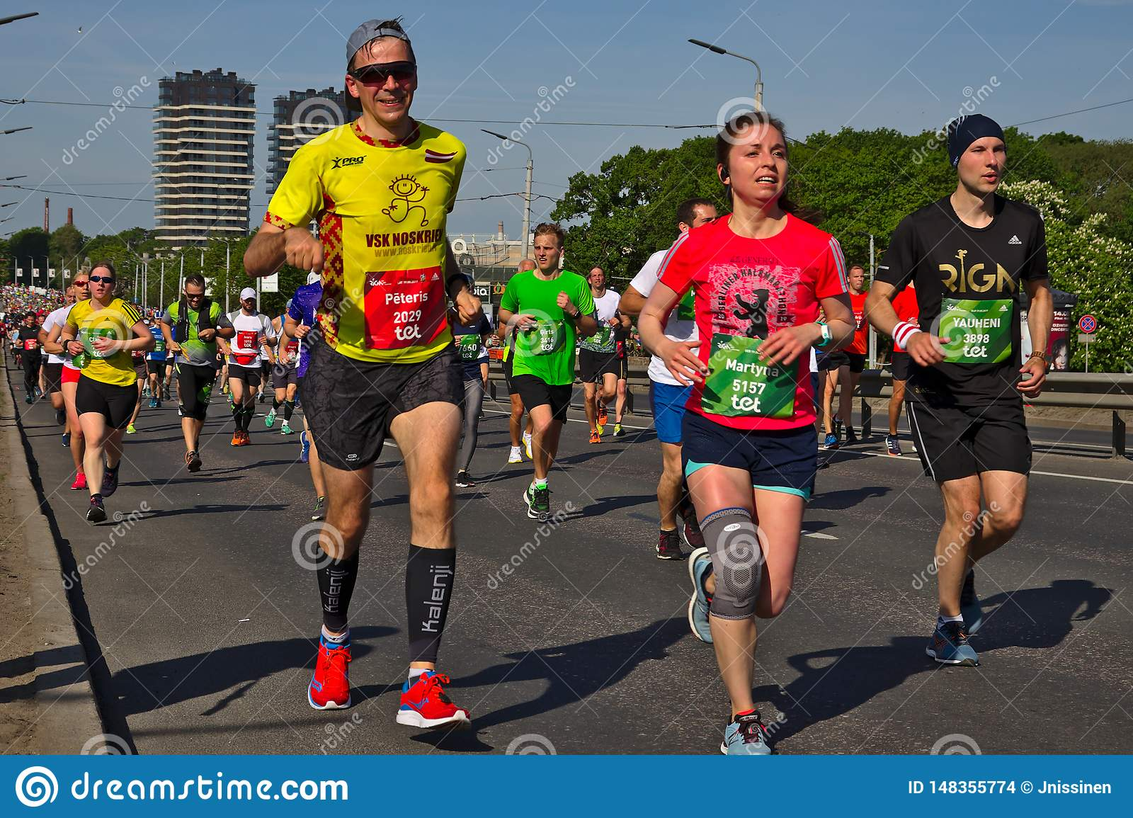 Riga, Latvia - May 19 2019: Male and Female marathon runners exhausted