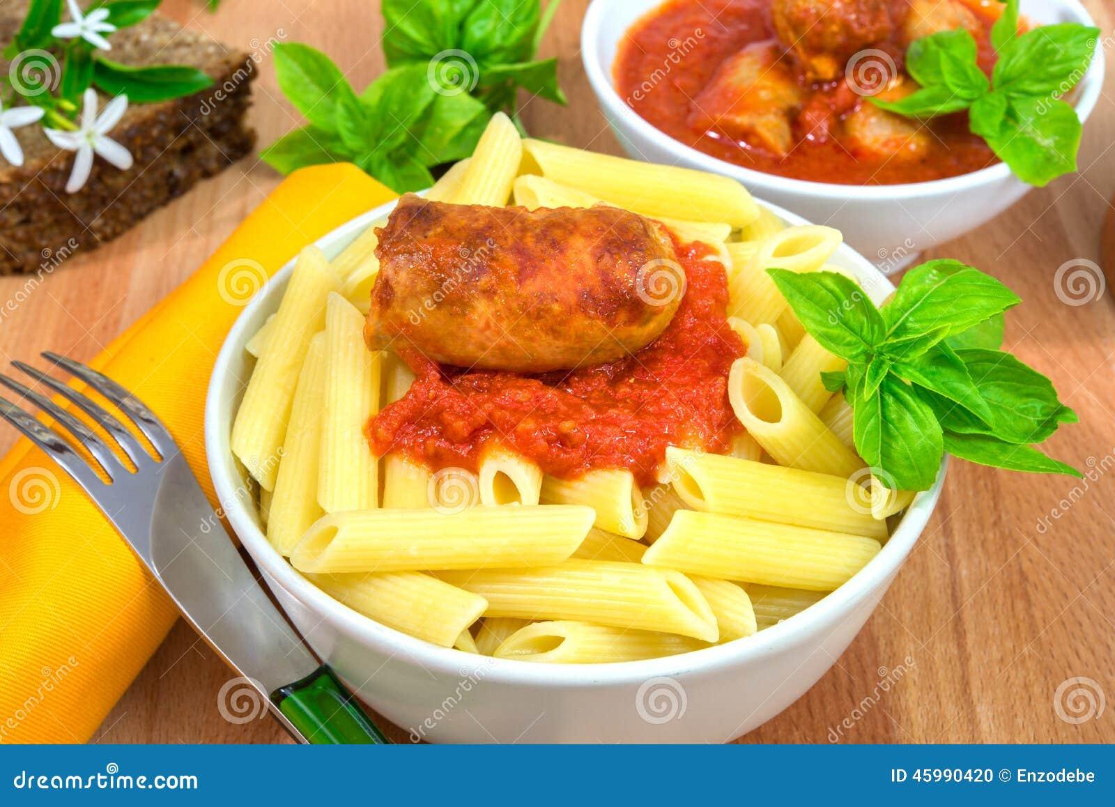 Rigatoni italian pasta with tomato ragu sausages sauce.