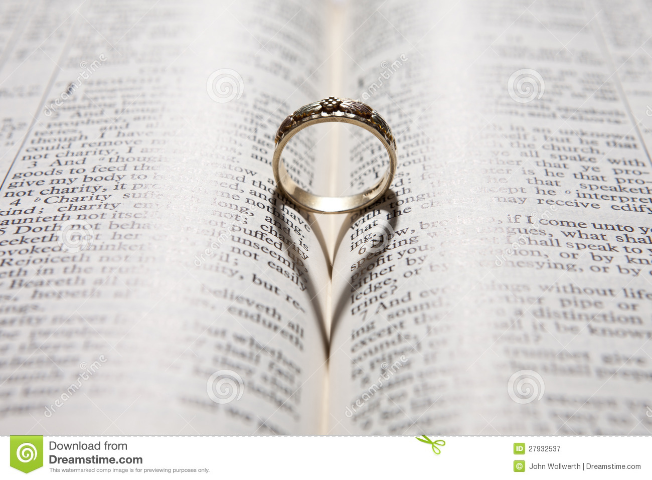 Ring casting heart shadow on bible stock image image for Wedding ring meaning bible