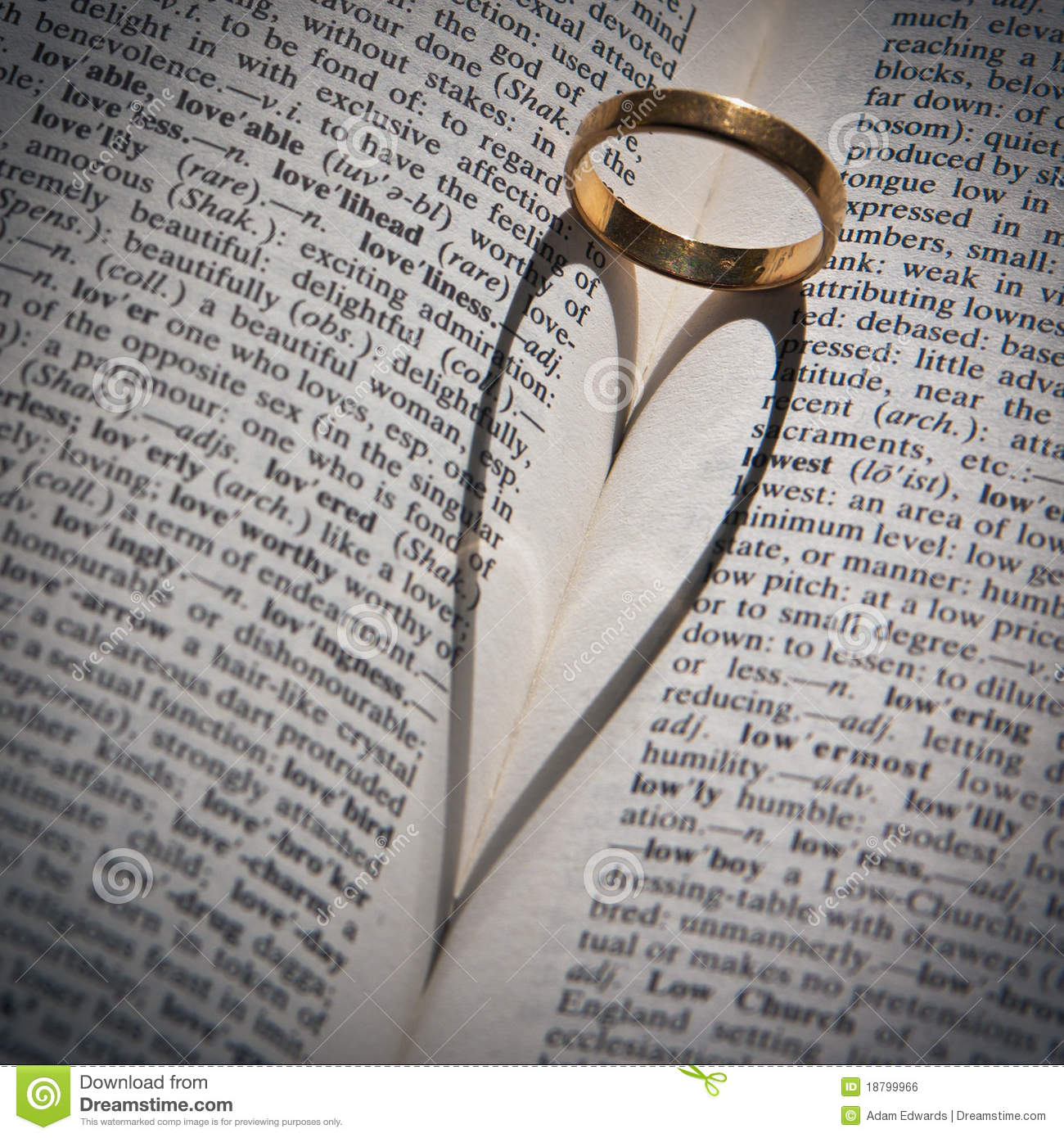 Ring Casting A Heartshaped Shadow In A Book Stock Photo Image of