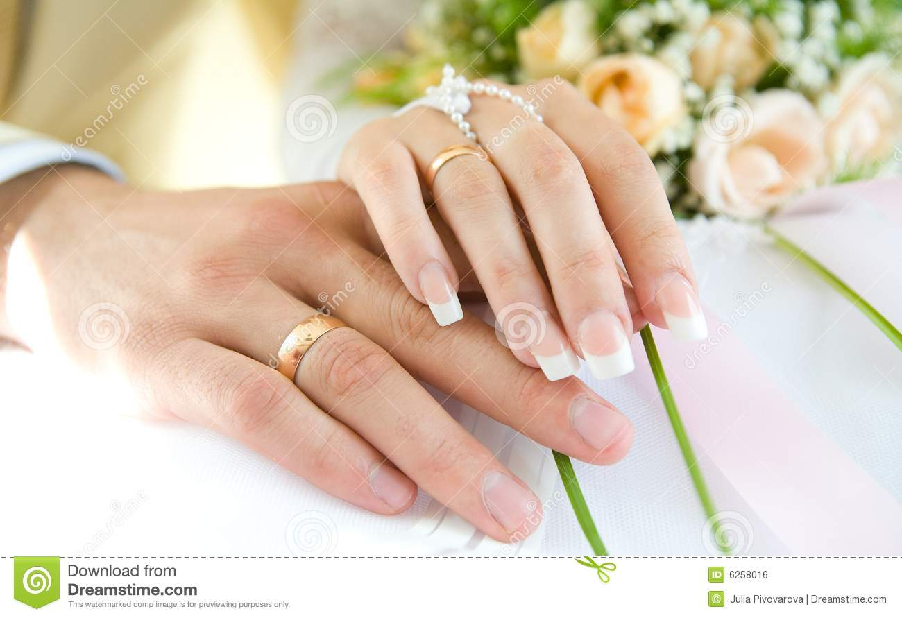 Ring Hands Over White And Flowers Wedding Day Stock Photo Image