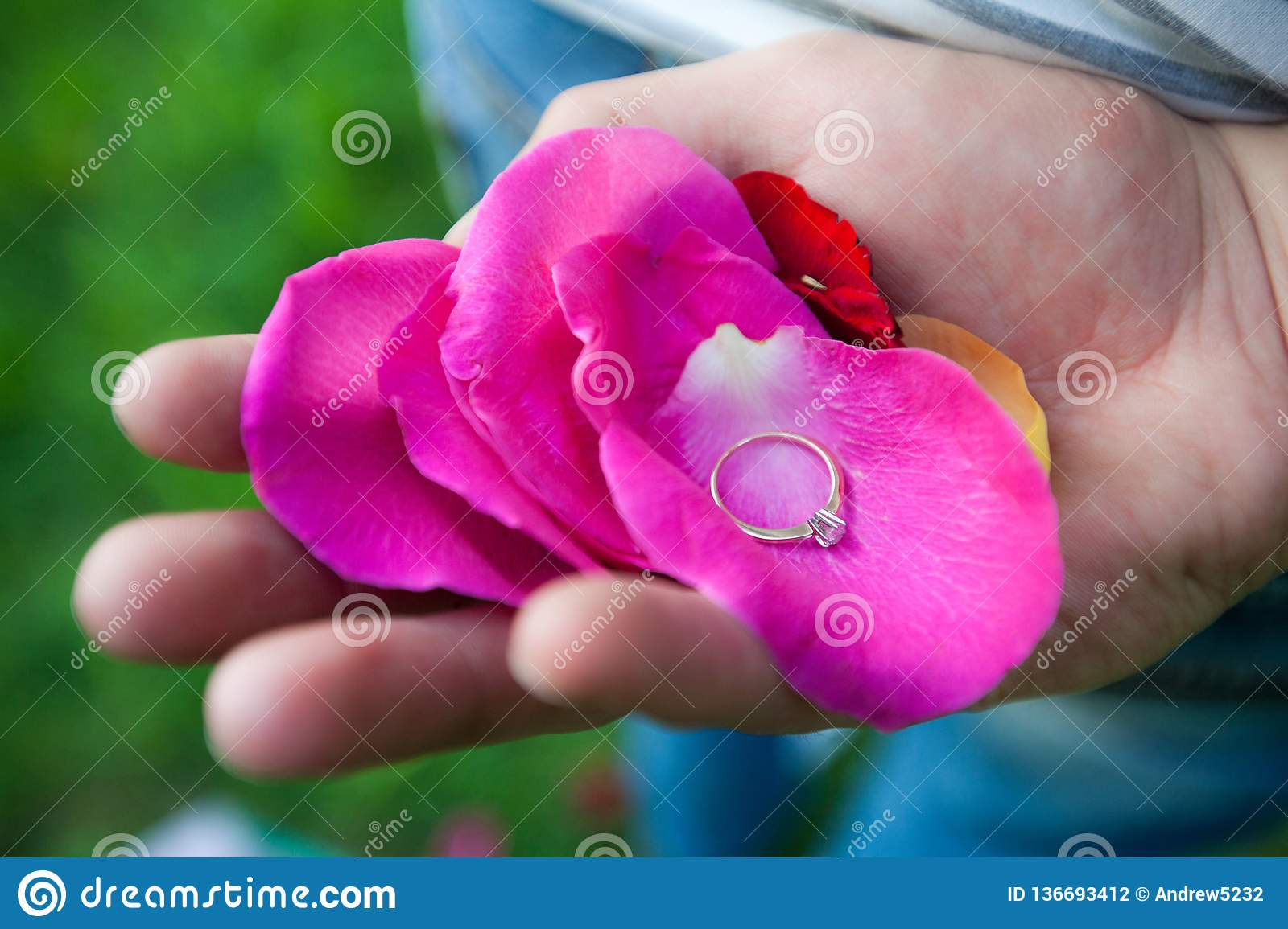Ring on the petals in hand