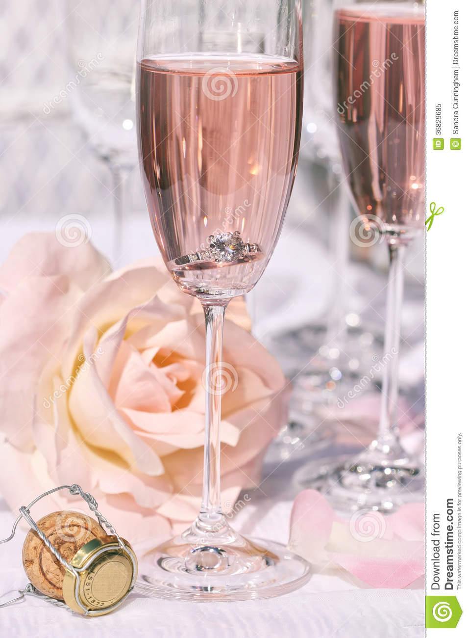 Ring In Pink Champagne With Flowers Royalty Free Stock