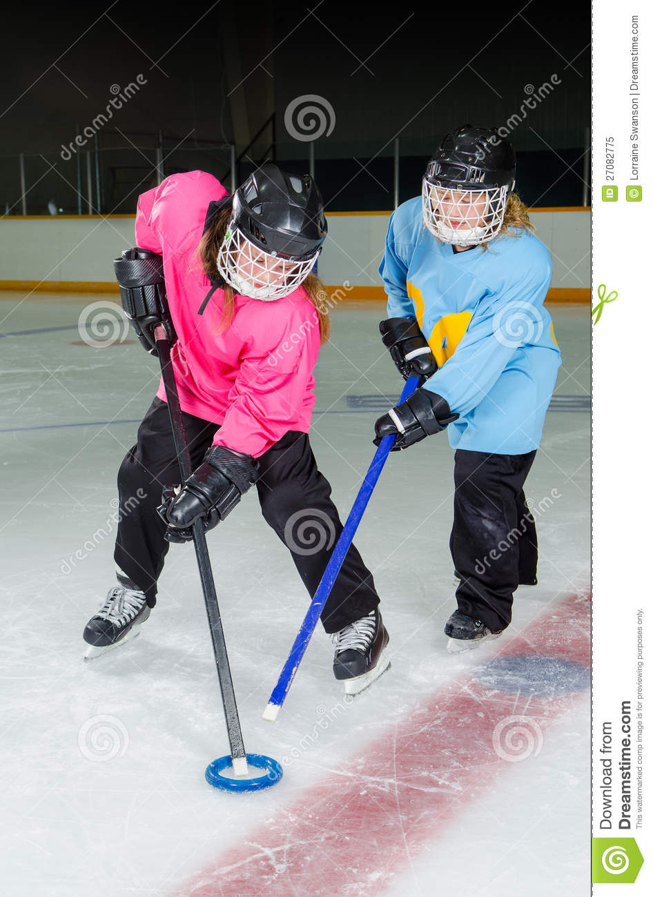 Ringette Players In Action At Hockey Rink Royalty Free