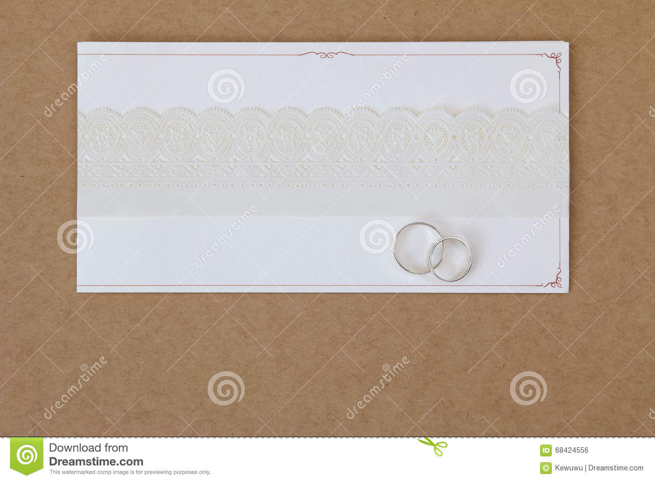2 Rings On A Wedding Invitation Card With White Paper Lace Ribbo ...