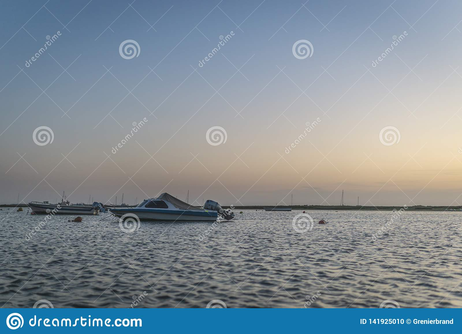 Rio Formosa boats floating at sunset