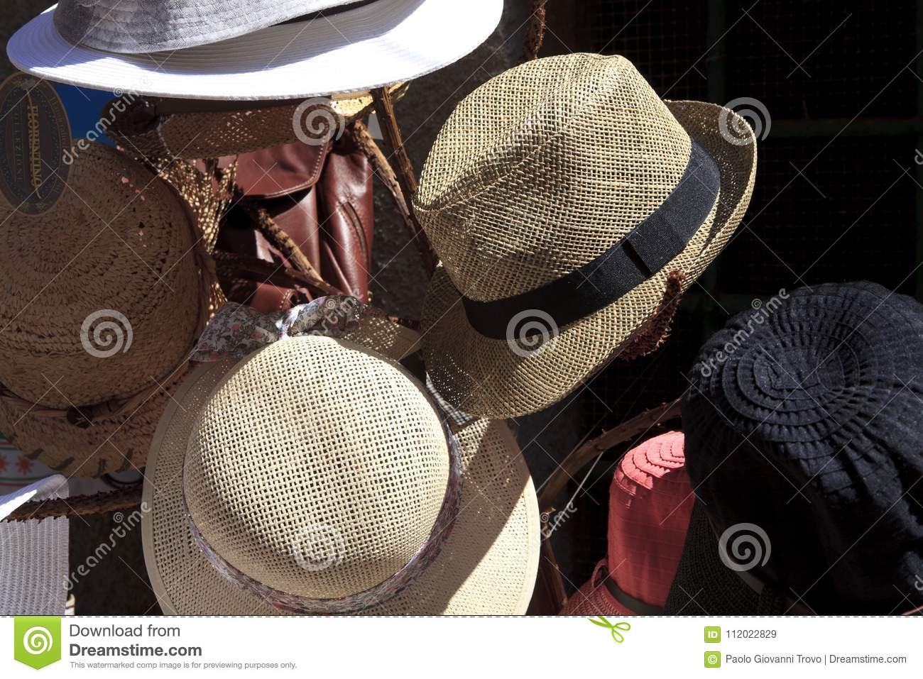 f896ddd9cce630 Riomaggiore SP , Italy - April 15, 2017: Hats near a souvenir shop in  Riomaggiore village, gulf of Poets, Cinque Terre, La Spezia, Liguria, Italy