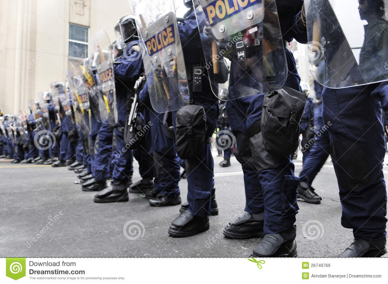 Riot police officers blocking the downtown streets