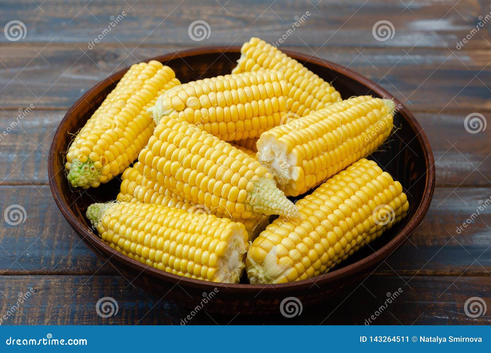 Ripe corn in a clay bowl.