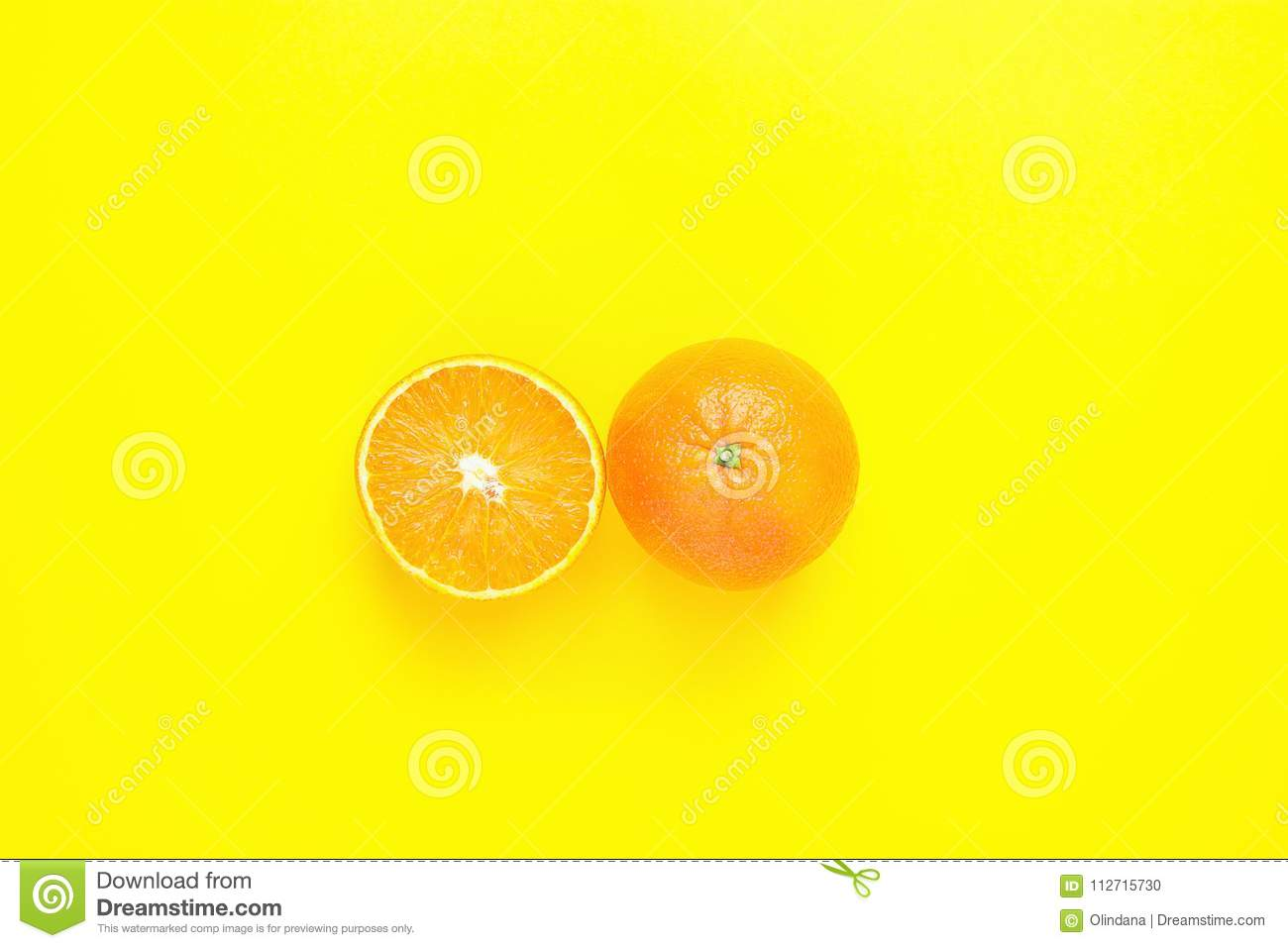 Ripe Juicy Whole and Halved Orange on Solid Yellow Background. Vitamins Healthy Diet Summer Detox Vegan Tropical Fruits