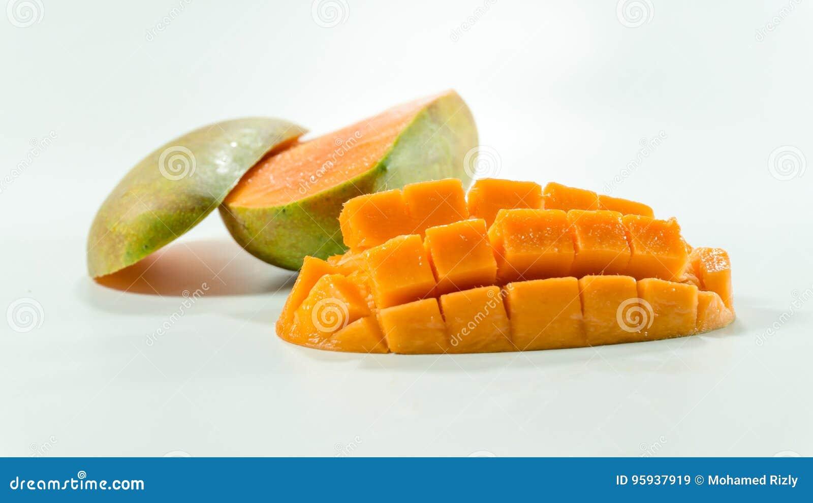 Ripe mangoes in white background/Fresh Sliced cubes.