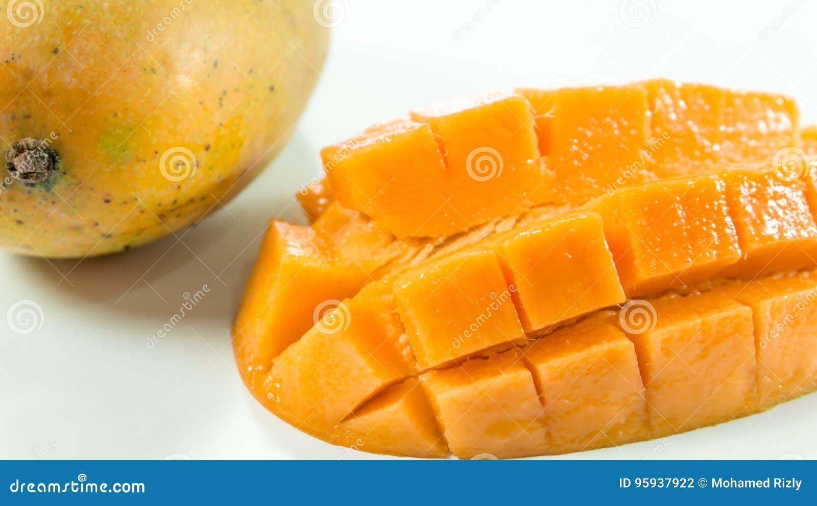 Ripe mangoes in white background/slice mango to eat