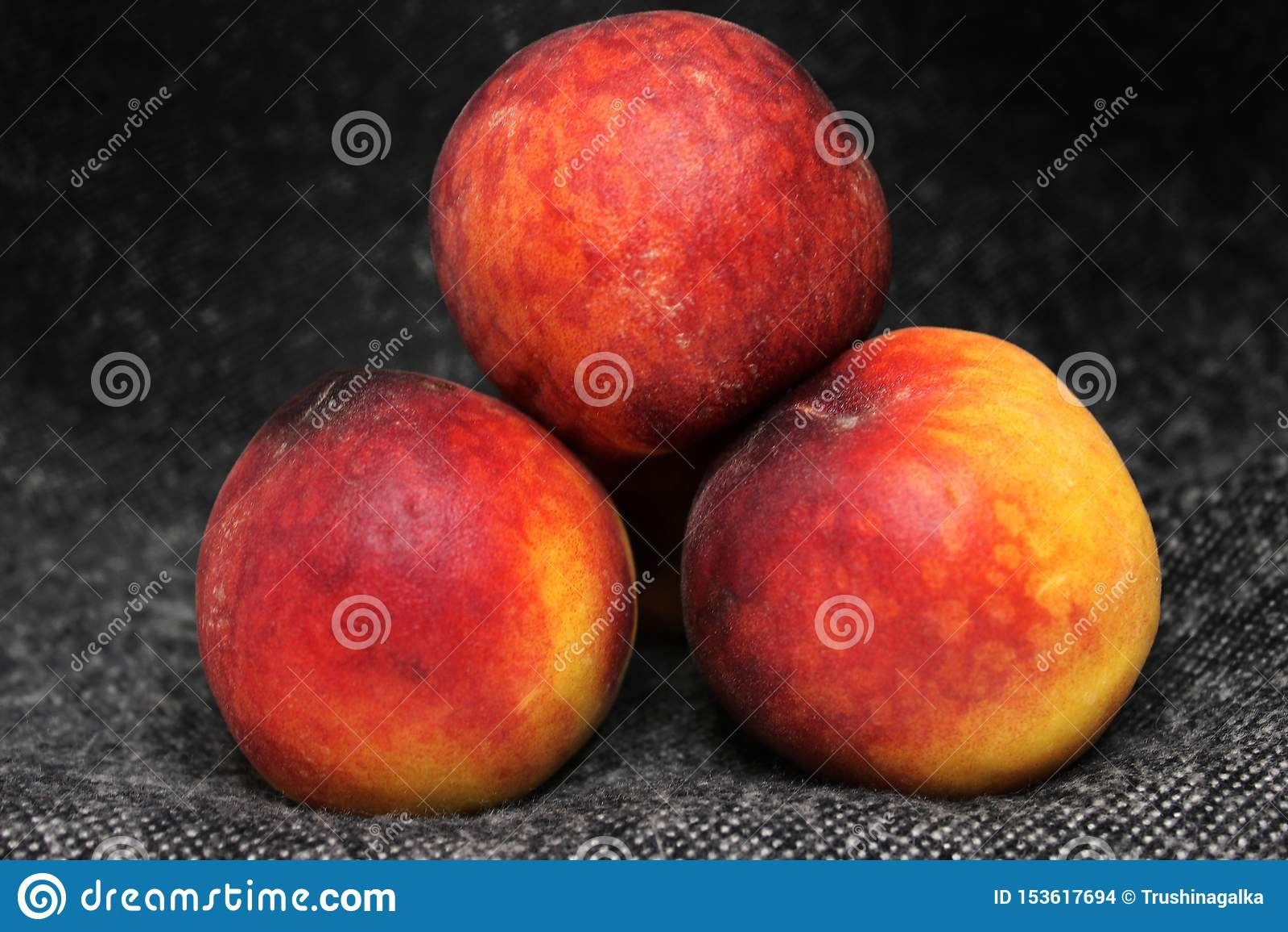 The peach on the dark background