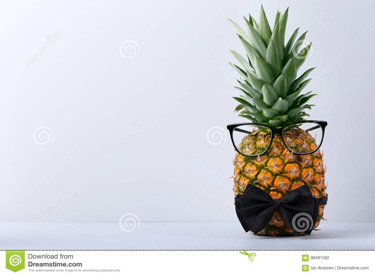 53dcbb390fbe Ripe pineapple with glasses and bow tie on grey background. More similar  stock images