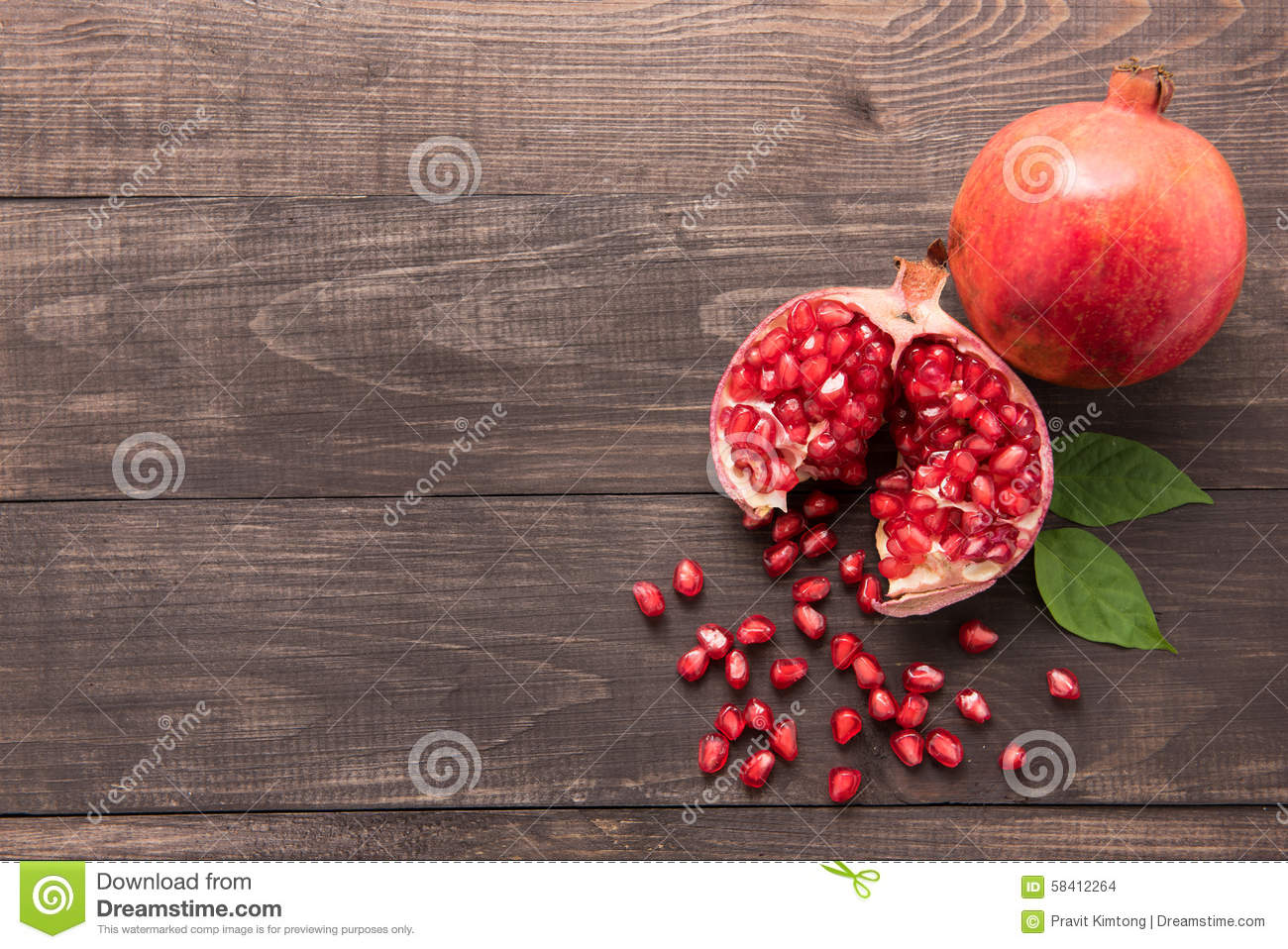 Ripe pomegranate fruit on wooden vintage background