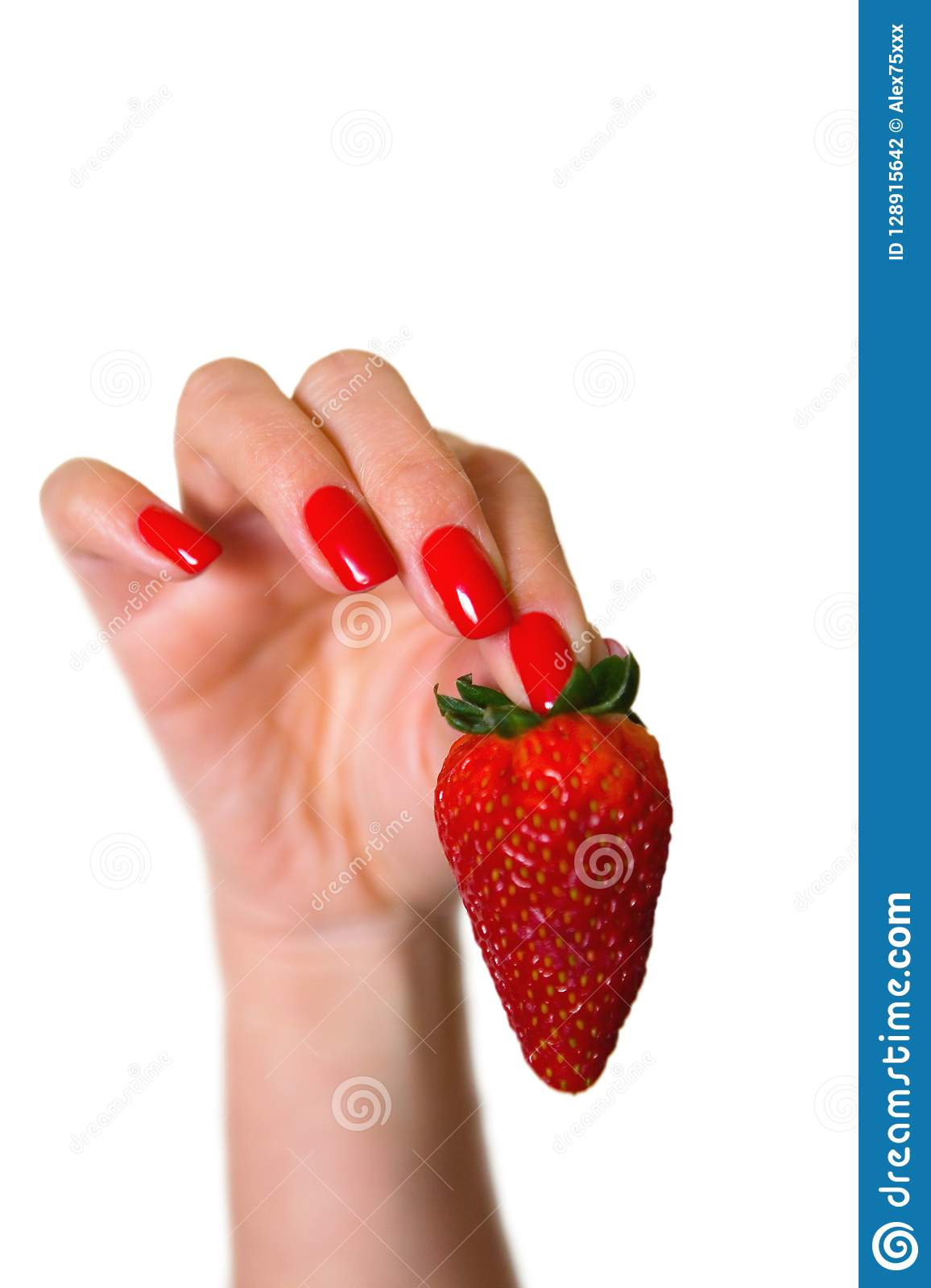 Ripe red strawberry in a beautiful female hand.