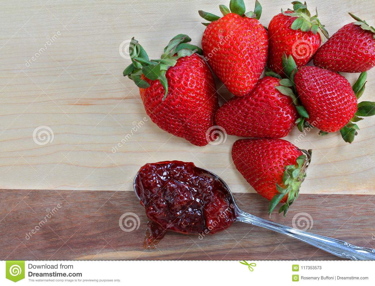 Organic Ripe And Fresh Strawberries On A Cutting Board With Spoonful Of Strawberry Preserves Macro Copy Space
