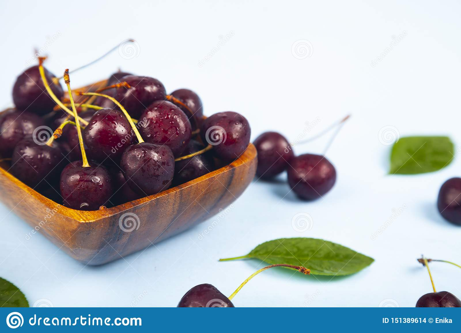 Ripe sweet cherry in a square bow