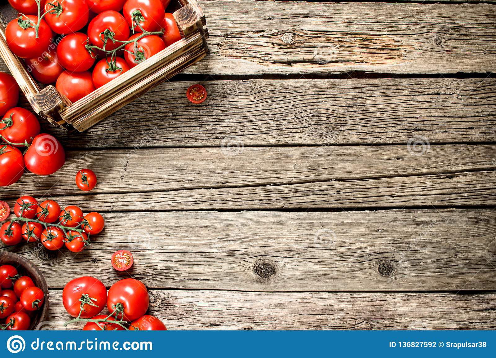 Ripe tomatoes in a wooden box