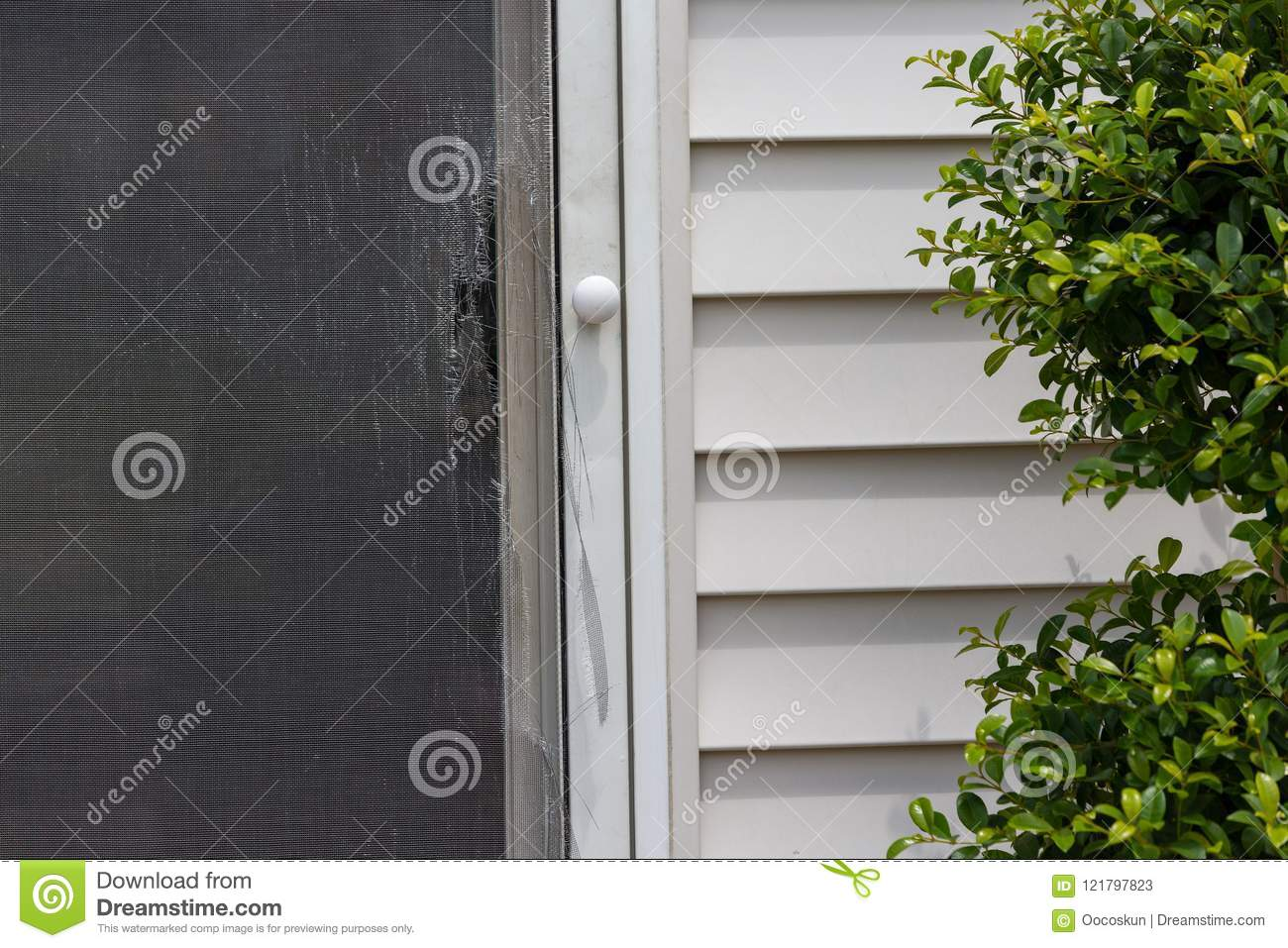 Ripped And Damaged Wire Mesh On A Screen Door Stock Image Image Of