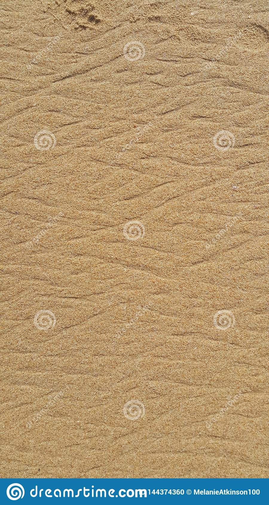 Ripples created on the beach sand as the tides move
