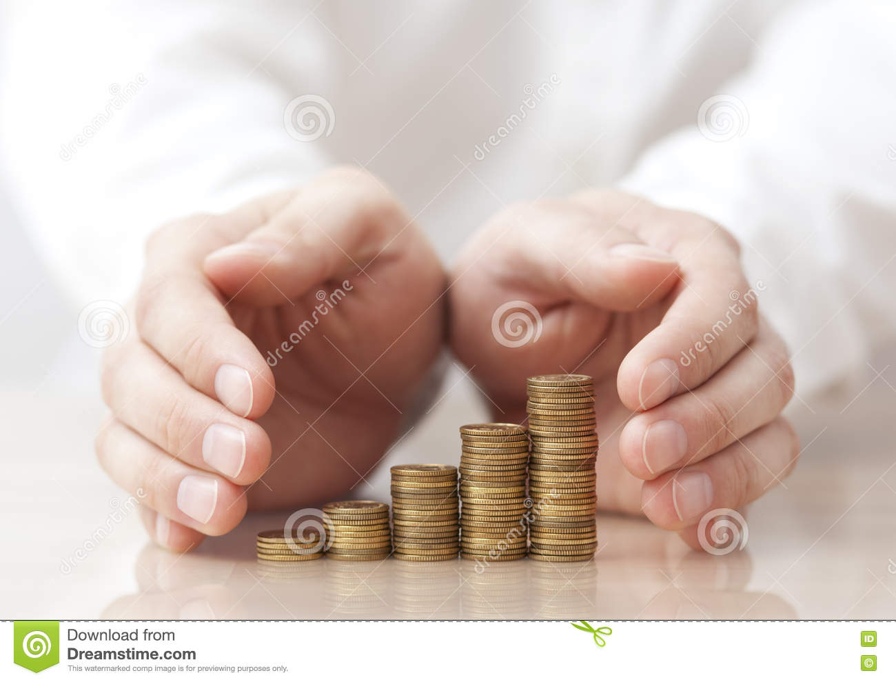 Rising coins protected under man s hands