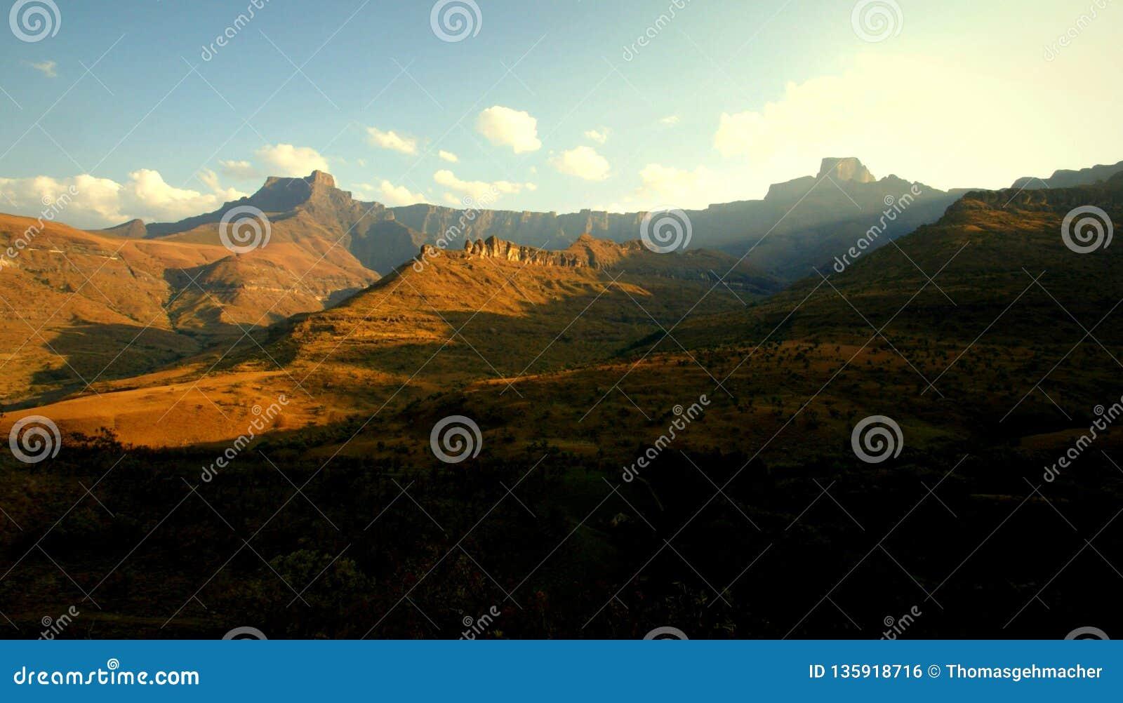 Rising morning sun at Drakensberg mountains, South Africa