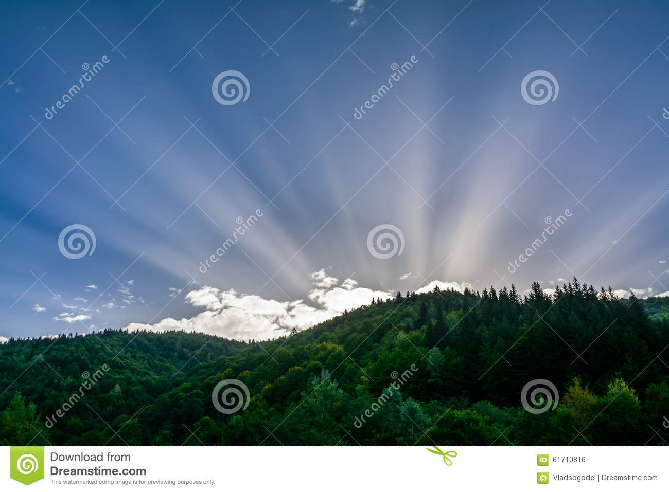 Rising sun on a background of the mountains. Horizontal colorful