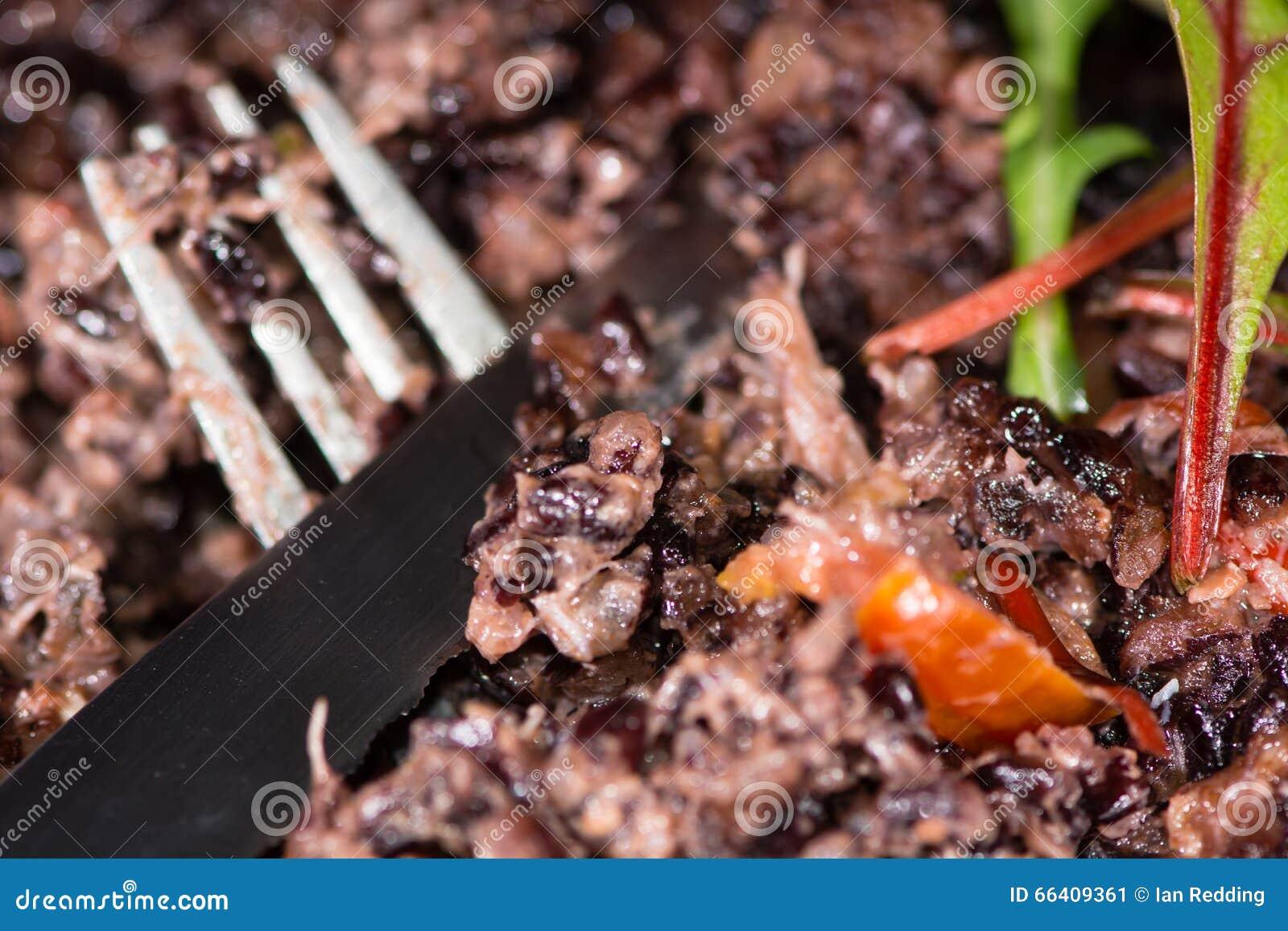 Crabe Avec Un Couteau risotto de crabe avec le couteau et la fourchette image stock