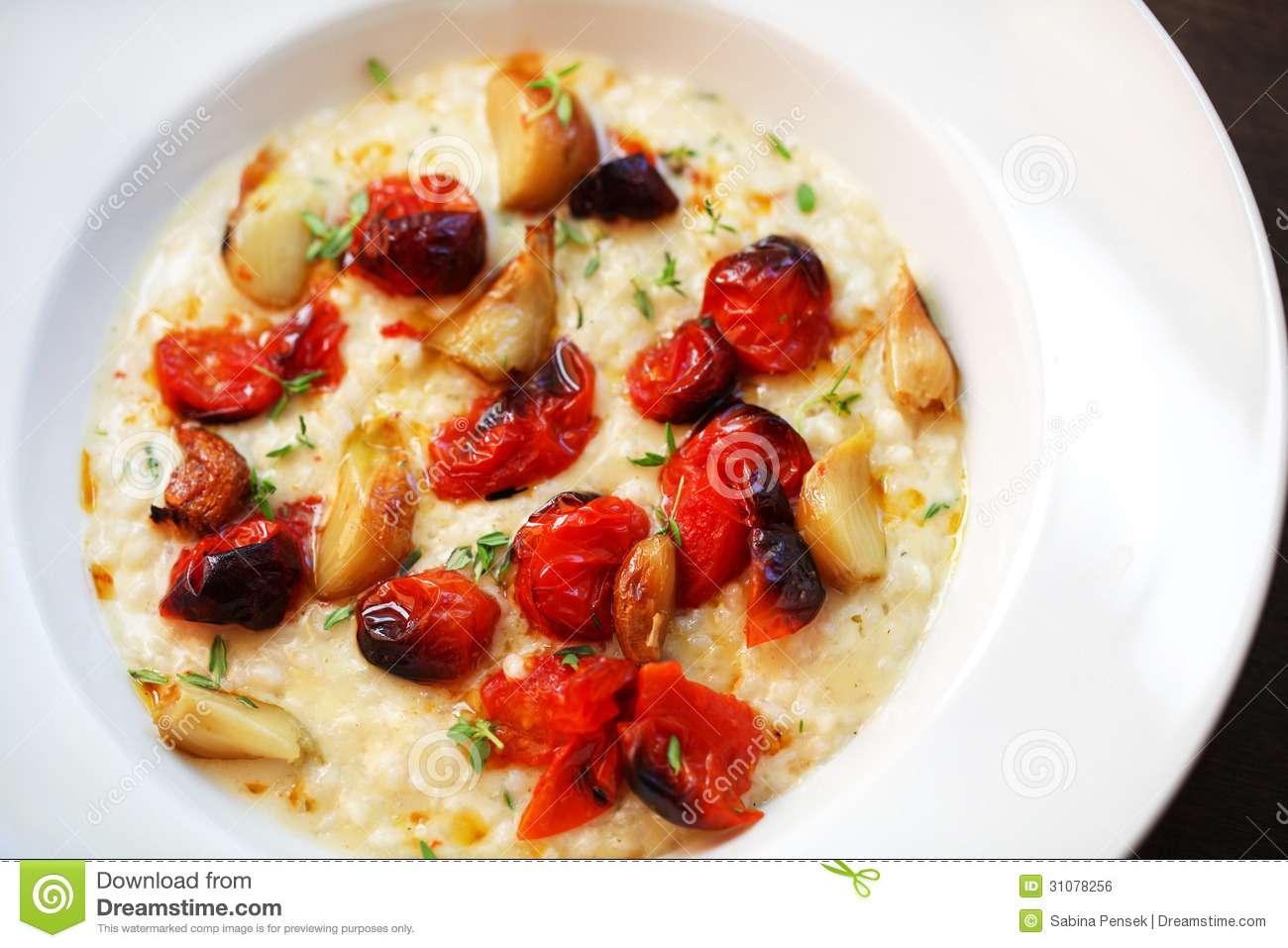 Risotto With Oven Roasted Cherry Tomatoes And Mozzarella Royalty Free ...