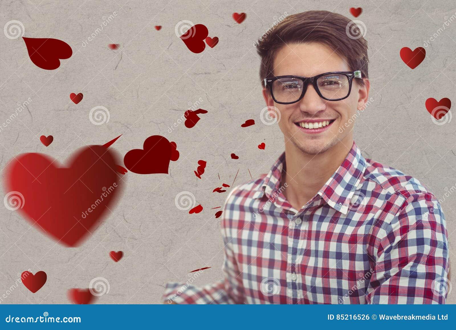 Ritratto dell uomo del nerd in occhiali contro i cuori rossi digitalmente generati
