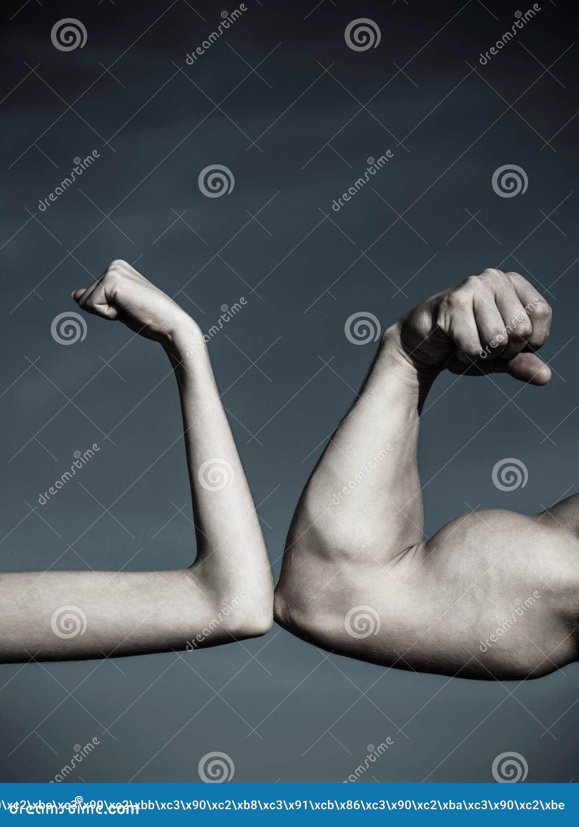 Rivalry, vs, challenge, strength comparison. Muscular arm vs weak hand. Vs, fight hard.Competition, strength comparison