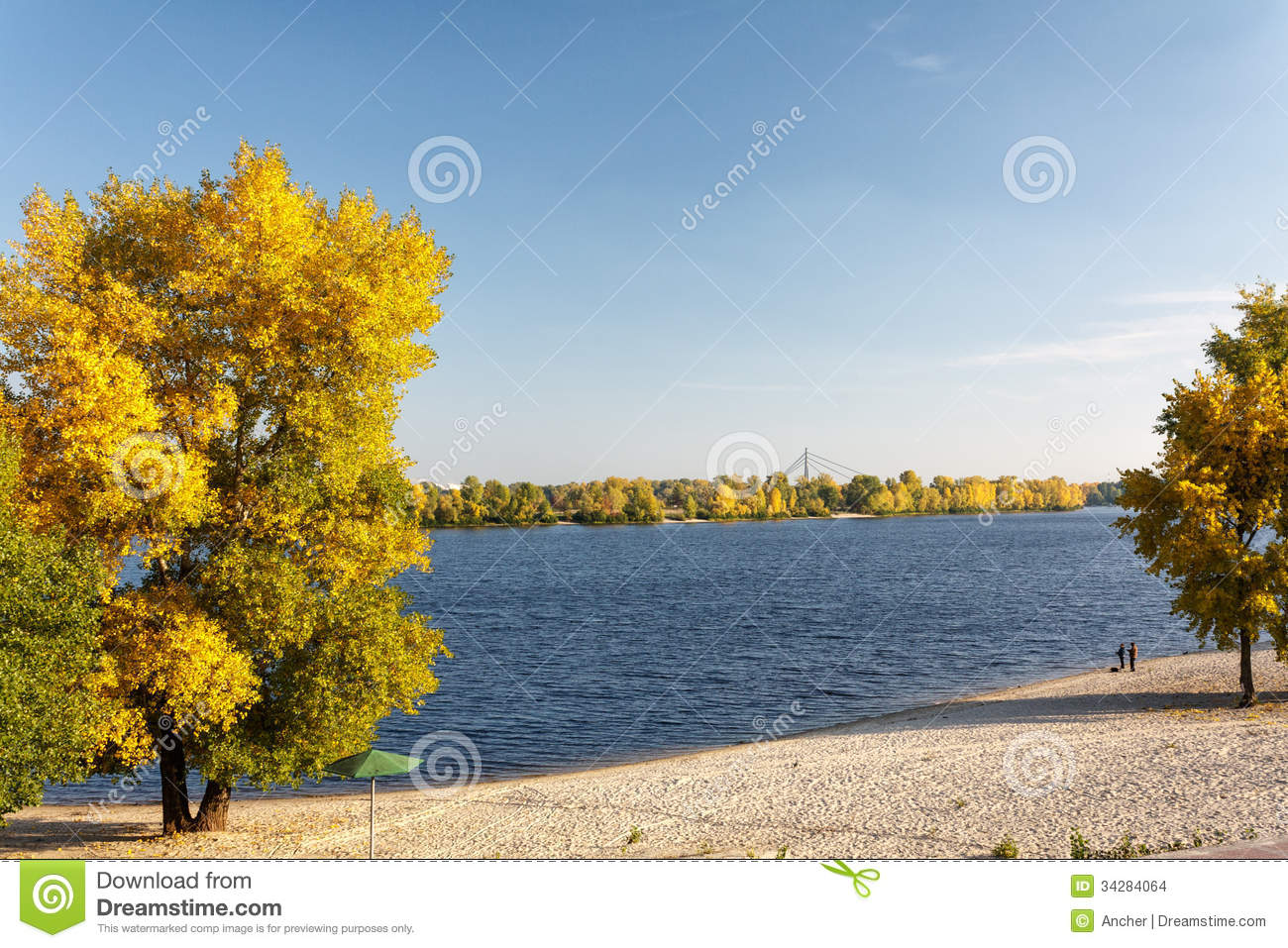 River autumn landscape with bright blue sky