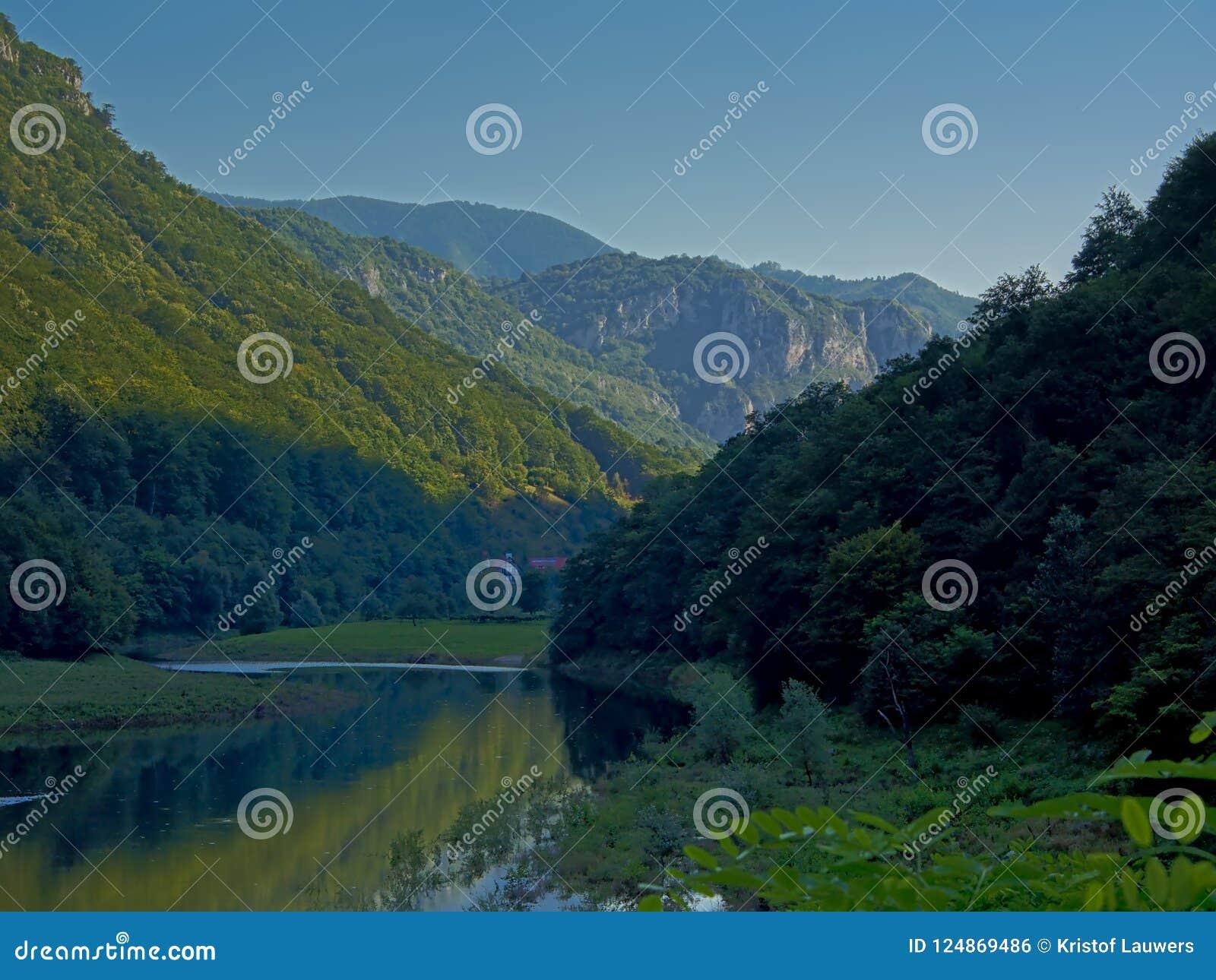 River Danube flowing in Romanian mountain landscape in early morning light
