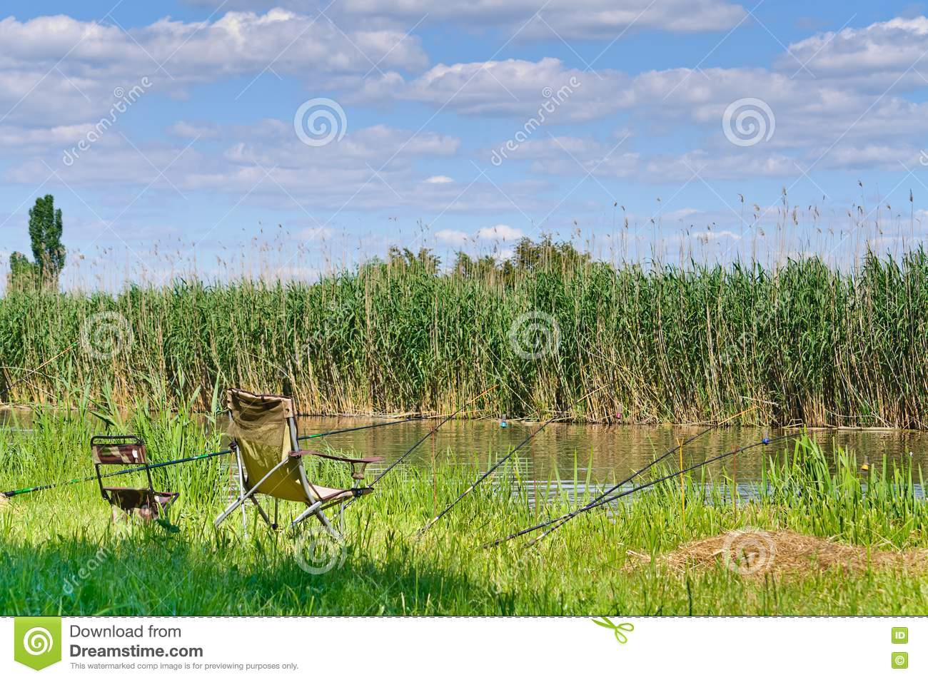 River fishing rods and deck chairs royalty free stock for River fishing pole