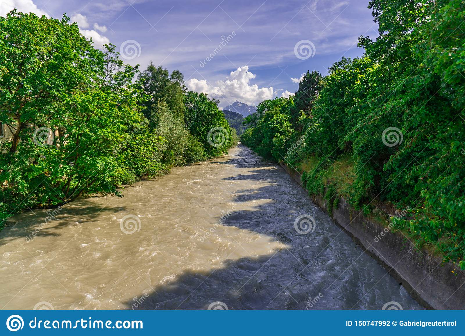 River with the green Trees and blue sky