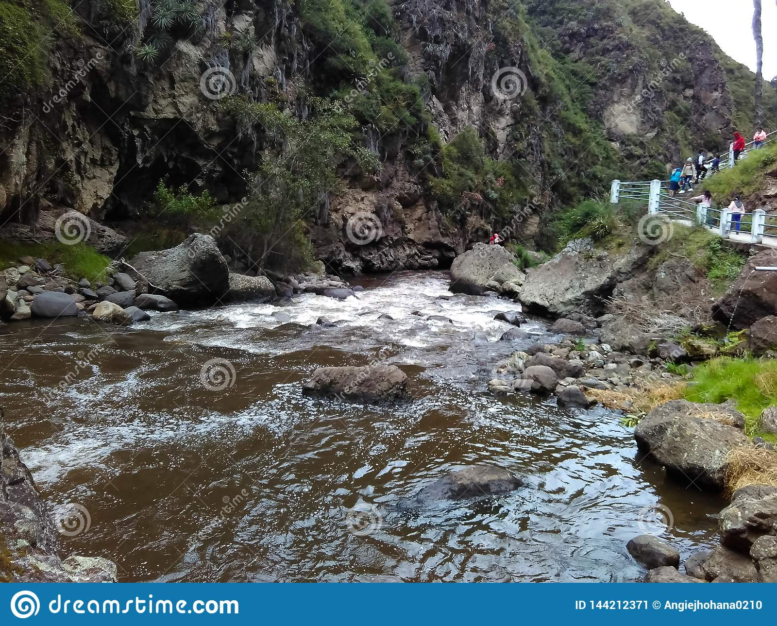 River running in a horizontal direction with rocks surrounding it